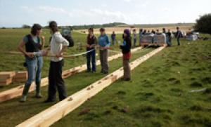 Archaeology students working on stone moving experiment. (Credit: Image courtesy of University of Exeter)